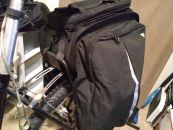 Image: The trunk bag side panels expand into panniers. The velcro straps underneath and in front attaches to the rack, and tie-downs secure the pannier bottoms to the rack frame...