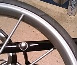 Image: The weakest part of the $20 granny cart, wheels with plastic spokes. I doubt these would carry more than 50 lbs...